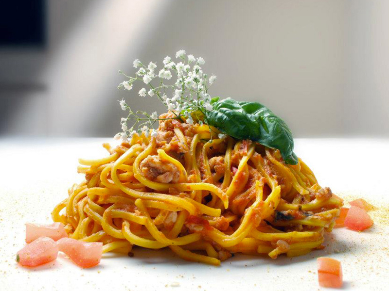 Homemade tagliolini pasta on lake perfume